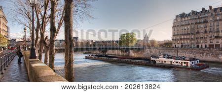 France, Paris - March 2008: View from the Quai de Bourbon on the Pont Saint-Louis, Quai aux Fleurs and  Seine River. France. Paris