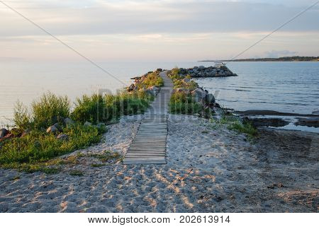 Winding bath pier by a sand beach at the swedish island Oland in the Baltic Sea