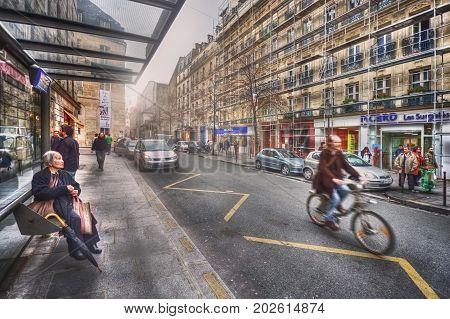 France, Paris - March 2008: Bus stop on rue des Francs-Bourgeois
