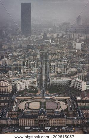 Tour Montparnasse, Institut des Hautes Etudes de Defense Nationale (IHEDN), UNESCO and commission nationale de l'informatique et des libertes (CNIL) from the Eiffel Tower during a snowstorm. France