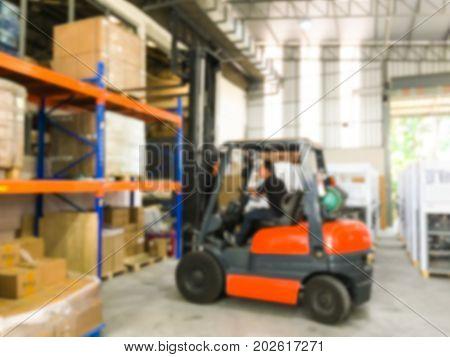 Blurred image Forklift loader for warehouse works indoors loading in shelf