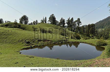 Heart shaped lake at Dayara Bugyal Uttarakhand India