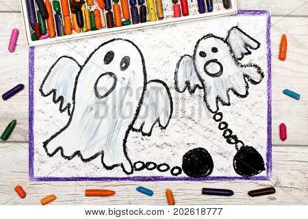 Photo of colorful drawing: Two scary ghost with chains
