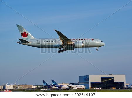 MONTREAL CANADA - AUGUST 28 2017 : Air Canada C-GHPU - Boeing 787 landing plane. Air Canada is the flag carrier and largest airline of Canada. The airline founded in 1937.
