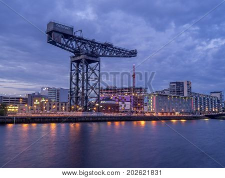 GLASGOW, SCOTLAND - JULY 21: The River Clyde with the Finnieston Crane on July 21, 2017 in Glasgow, Scotland. The Finnieston Crane is an important symbol of Glasgow's shipbuilding past.