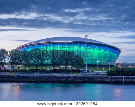 GLASGOW, SCOTLAND - JULY 21: The SSE Hydro at night on July 21, 2017 in Glasgow, Scotland. The Hydro arena is part of Glasgow's conference and event district.