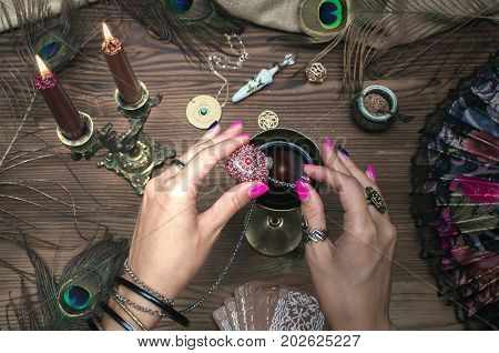 Fortune teller. Witch prepares a magic potion or love charm.