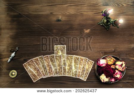 Tarot cards on wooden table. Fortune teller table.