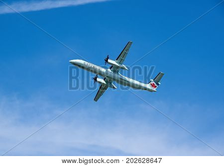 MONTREAL CANADA - AUGUST 28 2017 : Air Canada Express taking off plane. Air Canada Express is a brand name under which four regional airlines operate feeder flights for Air Canada.