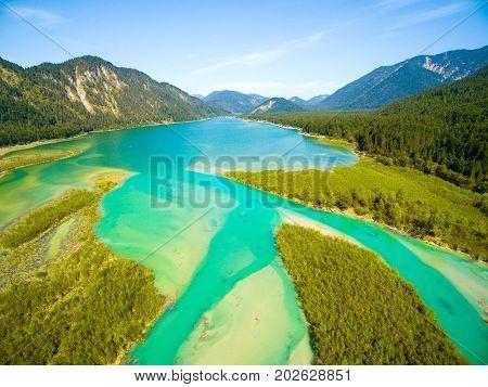 Aerial view on Isar River that flows to Sylvenstein Lake in Bavarian Alps near Garmisch Partenkirchen. Germany, Central Europe.
