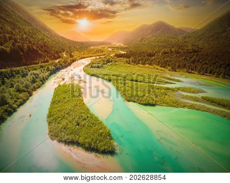 Aerial view on Isar River that flows to Sylvenstein Lake in Bavarian Alps near Garmisch Partenkirchen. Sunset over Isartal. Germany, Central Europe.