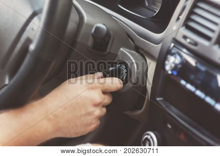 Man's Hand Starts A Car With The Key In Retro Toning