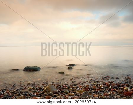 The Famous Beach In Island In Romantic Colors. . Stones And In Beach Sand.