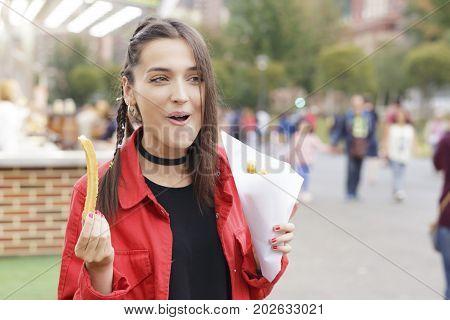 Girl In The Fair, Eating Spanish Snack Named
