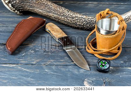 Knife with a fixed blade and leather sheath. Hunter accessories.