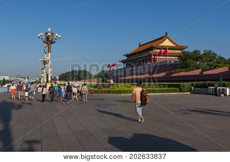 Beijing China - July 28 2012: People at the entrance of the Forbidden City in the city of Beijing in China