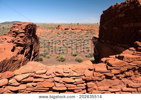 Desert view from Wukoki pueblo in Wupatki National Monument with a volcanic cinder cone in the background
