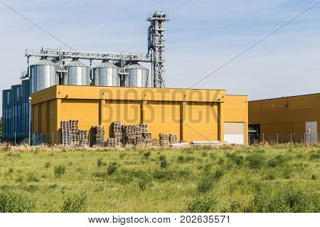 External view of a typical factory Building with agricultural silos