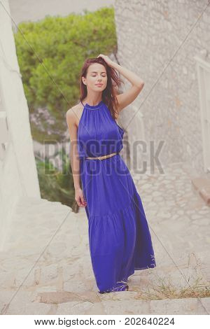Photo Of Beautiful Young Woman Standing On The Stairs Near The Houses In Greece