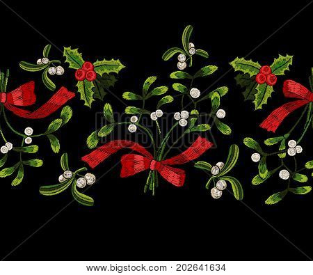 Embroidery christmas seamless pattern with mistletoe. Vector embroidered floral template for fashion design.