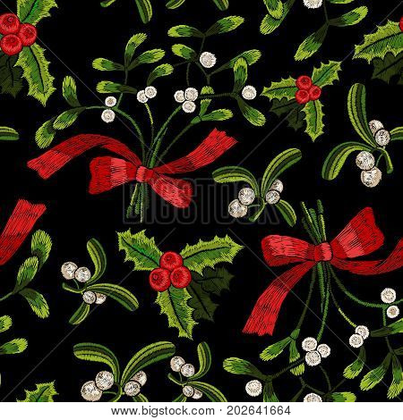 Embroidery christmas seamless pattern with mistletoe. Vector embroidered floral elements for fashion design.