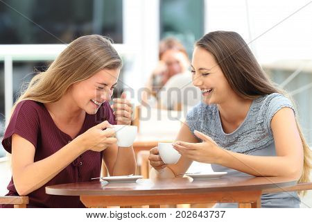 Best Friends Laughing Loud During A Conversation In A Bar