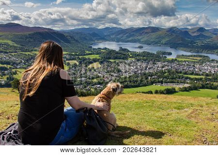 Girl And Dog Gazing At Keswick And Derwent Water, Cumbria