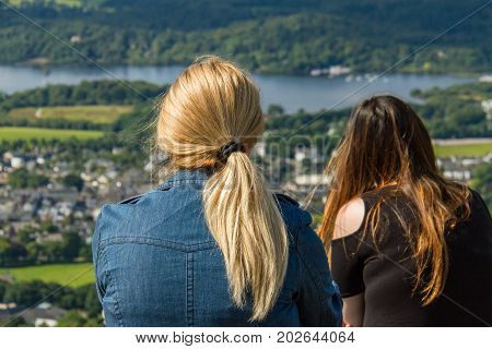 Woman And Girl Gazing At Keswick And Derwent Water, Cumbria