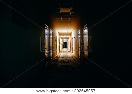 Dark corridor or hallway with many doors, vintage toned