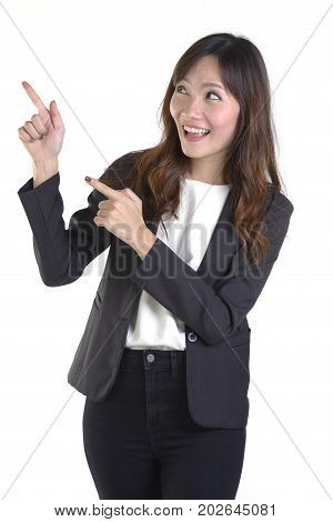 Happy business women pointing aside at white copy space isolated on white background.