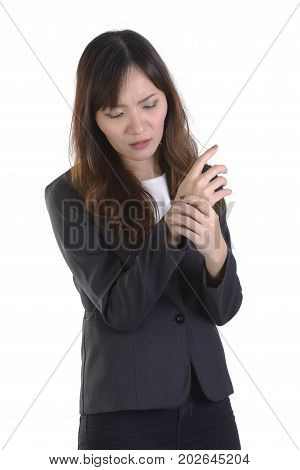 Business women in business suit wrist pain on pure white background.