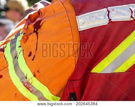 Fake blood clothes fireman outdoor closeup background
