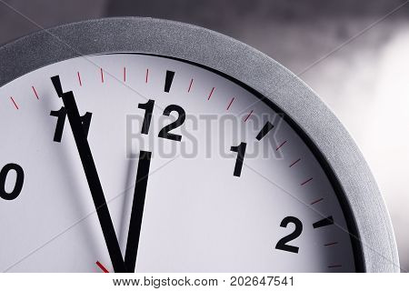 Wall Clock Showing Five To Twelve