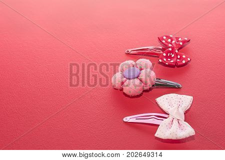 Three buckles with bows and flowers. On white background.
