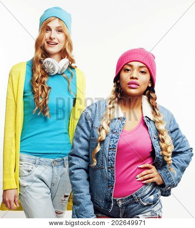 diverse nation girls group, two diverse rase teenage friends company cheerful having fun, happy smiling, cute posing isolated on white background, lifestyle people concept close up
