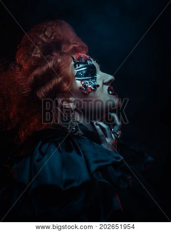 Gothic redhair witch. Dark woman. Halloween picture.