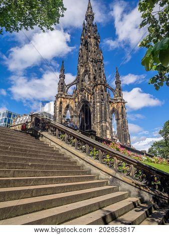 EDINBURGH, SCOTLAND - JULY 26: Statue of Sr Walter Scott at the base of the Scott Monument at night on July 26, 2017 in Edinburgh Scotland. Scott is Scotland's most famous writer