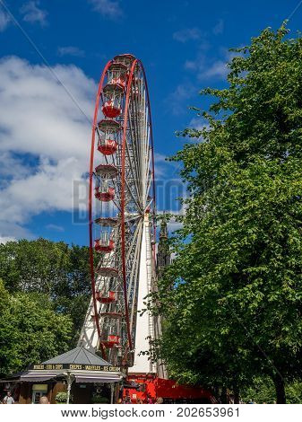 EDINBURGH, SCOTLAND - JULY 26: View of the Festival Wheel, a large and temporary mechanical Ferris Wheel, on July 26, 2017 in Edinburgh, Scotland. It is located in East Princes Street Garden.