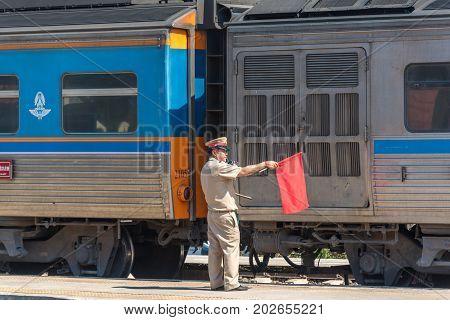 Pointsman Holding Red Flag On Train Station Platform