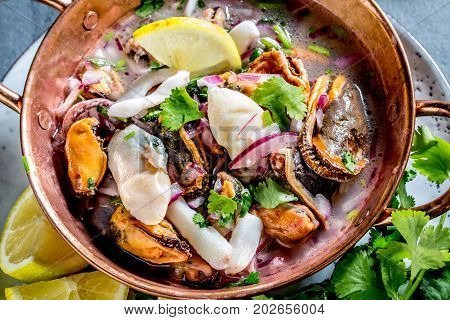Peruvian Latin American Seafood Shellfish Ceviche Cebiche. Raw Seafoods - Mussels, Shrimps, Clams, S