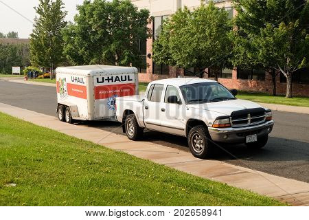 Denver, Colorado, USA - August 7, 2017: U-Haul cargo trailer at a street. U-Haul truck is a moving equipment and storage rental company.