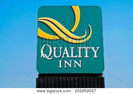 Denver, CO, USA - August, 2017: Logo of the Quality Inn Hotel and Suites in Denver, Colorado.