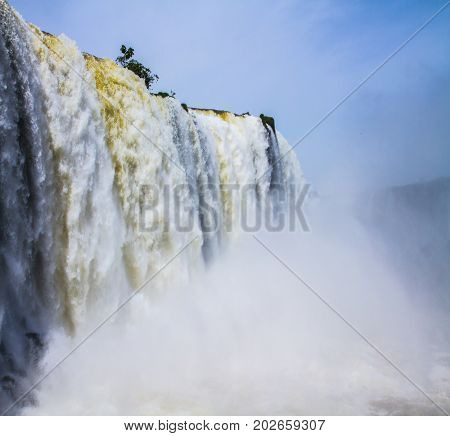 The improbable exotic Iguazu Falls in South America, on border of three countries: Brazil, Argentina and Paraguay. Concept of active and extreme tourism
