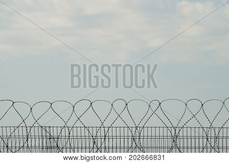 Barbed wire against the sky Forbidden zone
