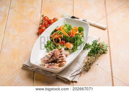 stuffed rolled up swordfish with mixed salad