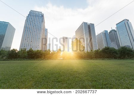 city downtown district with green lawn,dalian city,china.