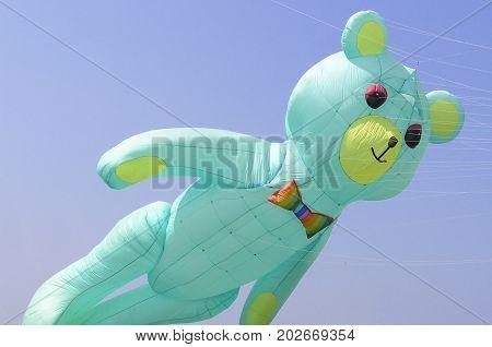 Beautiful big blue bear kite in a kites festival
