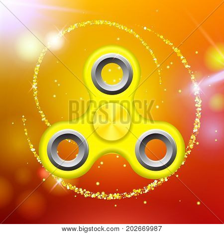 Orange colorful spinner on an abstract background with orange luminous backdrop. Abstract background with orange luminous backdrop. Modern children's orange toy - spinner.