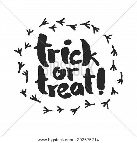 Trick or Treat. Hand written calligraphy slogan inside a frame of raven traces. Isolated on white background. Clipping paths included.