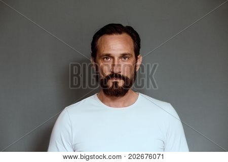 Man actor on grey background in studio. Mature man on casting in studio.